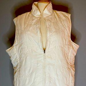 Gently worn woman's reversible beige vest.